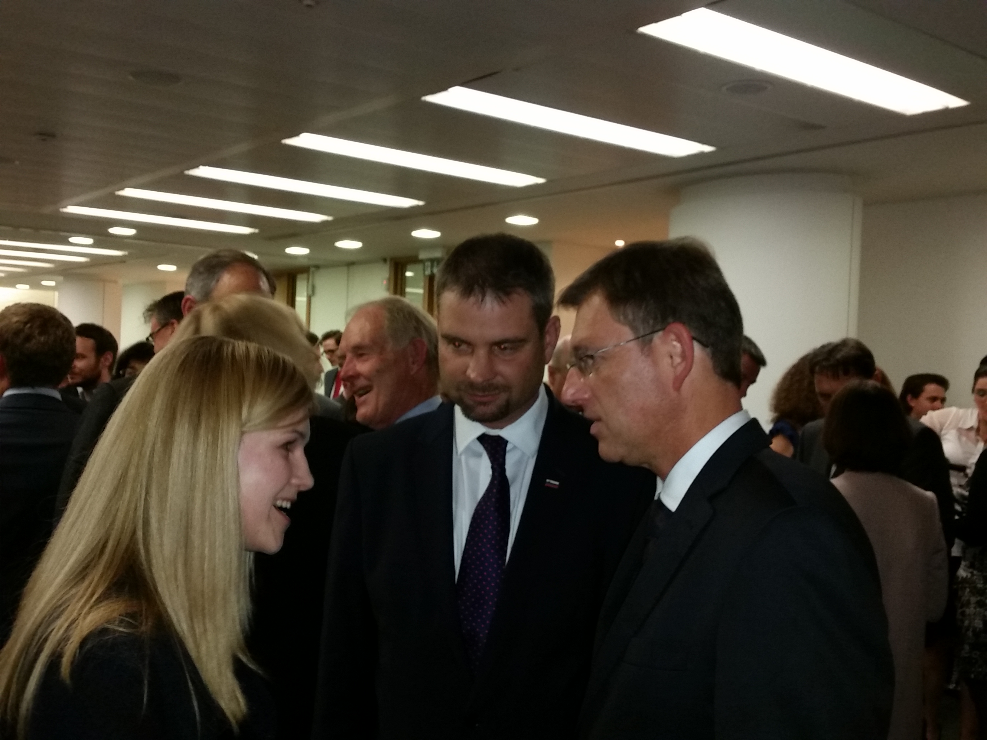 Slovenian Prime Minister Miro Cerar talks with Maja Rančigaj, teacher of Slovene at the University of Nottingham